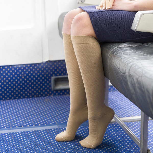 Airline crew wearing flight socks on front row