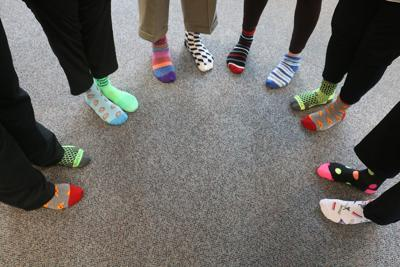 Group of people wearing multi-colored compression socks