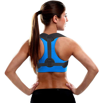 a woman in exercise clothes wearing a back brace and with her hands on her hips