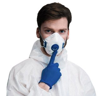 Man in respirator mask and coveralls.