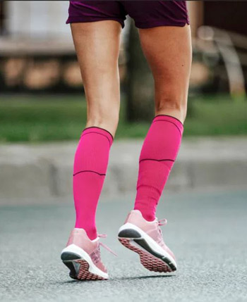 Woman Running with the Best Compression Socks On