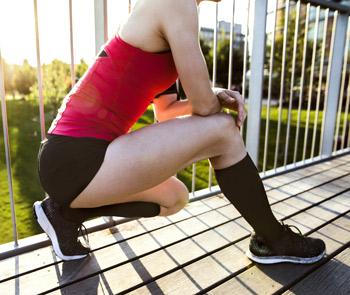 Woman wearing knee high compression socks