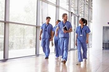 nurse walking in hospital wearing socks