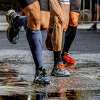 Runners wearing knee high Compression Socks