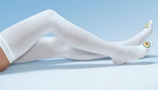 image of a woman sleeping with anti embolism stockings