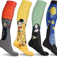 A variety of compression socks picturing several different works of art like the Mona Lisa.