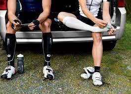 men athletes wearing compression socks