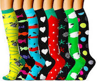 Several festive compression socks ranging from yellows and greens to strawberries and stripes.