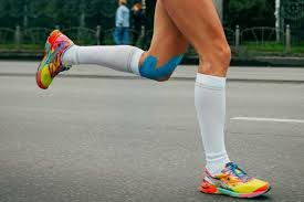 person running in compression stockings