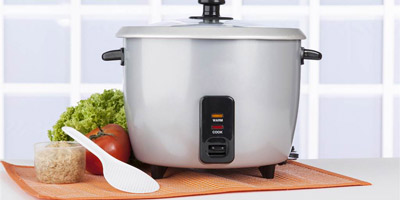 example of a standard no-frills circa 1980s silver-colored rice cooker