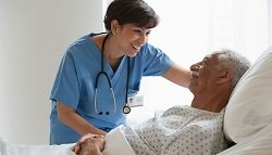 nurse assisting a patient in hospital