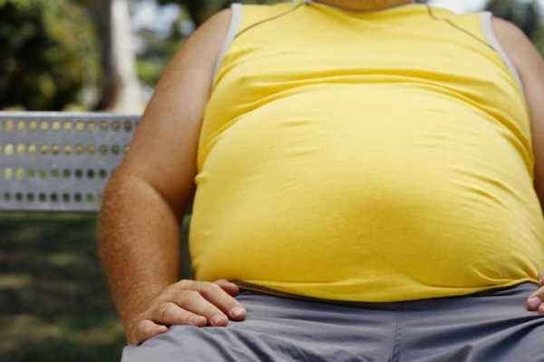 Man with obesity in yellow t-shirt