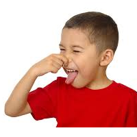Boy holding his nose and sticking out his tongue because of a foul odor presumably from compression gear