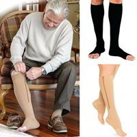 An old man on sleeves wearing a knee high zipped compression stockings for support