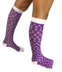 person wearing purple and white compression socks