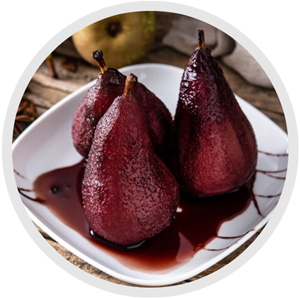 a dish of poached pears decorated with chocolate sauce and plated on a plain white plate