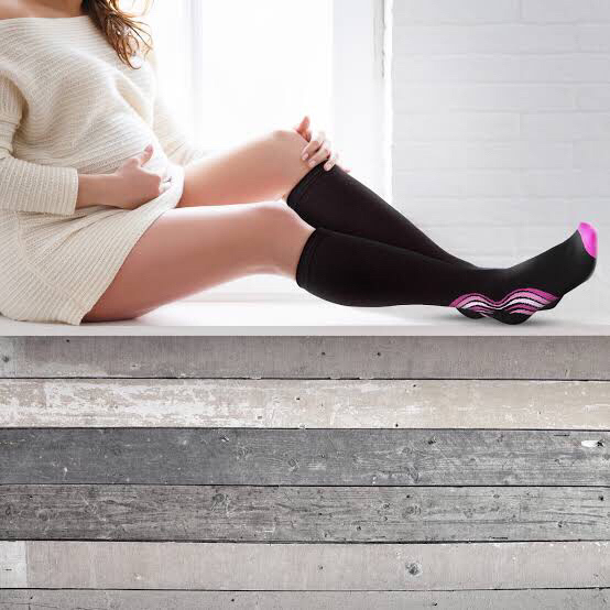 pregnant woman wearing compression socks