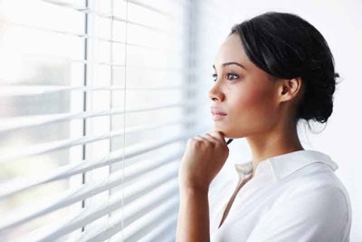 Woman thinking about the best compression socks for edema