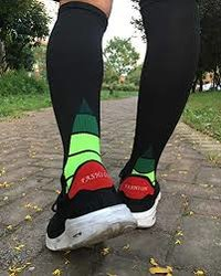a runner wearing black colored compression stockings