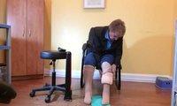 a man putting on compression socks