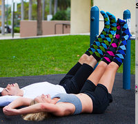 two people lying on the ground wearing compression stockings