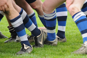 Rugby Team Wearing Compression Socks. These are blue and white and black compression garments.