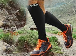 person running on mountains with compression socks