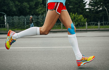 Wearing white compression socks while running