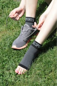 image showing a sports person wearing ankle socks for compression