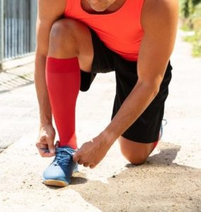 image of a runner wearing compression socks