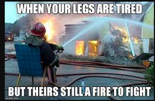 tired fireman sitting while putting a fire out should try compression sleeves for leg endurance