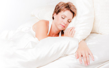 A woman sleeping in bed