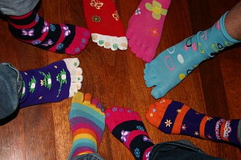 picture of people wearing multicolored compression socks