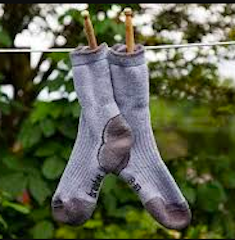 A picture of socks drying on a hanging line