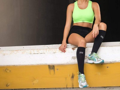 sportswoman wearing compression socks