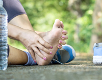 woman-suffering-from-pain-and-swelled-foot-during-sports