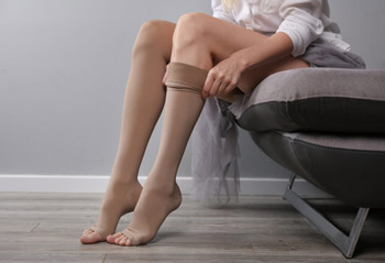 Woman wearing best compression stockings for edema