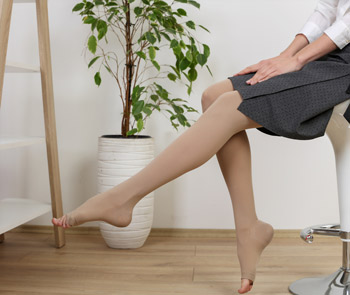 Woman Stretching wearing Compression Stockings