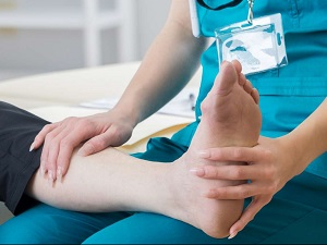 image of doctor treating swelled legs of patient