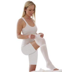 image of a lady wearing white anti embolism legwear