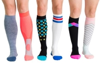 three people in different coloured compression socks