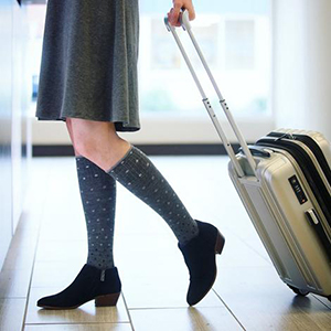 woman getting off the plane while wearing compression