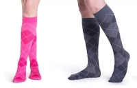 two people wearing pink and grey comression socks