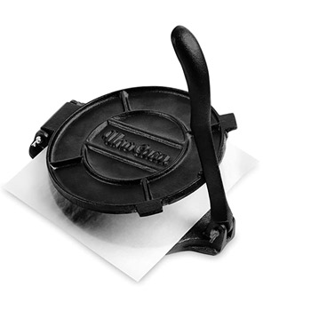 Cast Iron Tortilla Press with Paper in the Middle