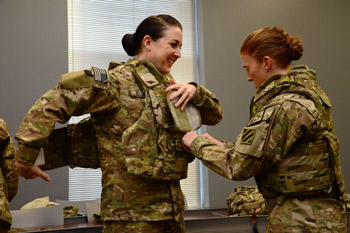 Female soldiers gearing up