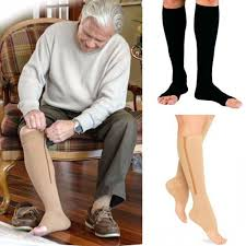 old person wearing zippered up compression socks sitting on chair