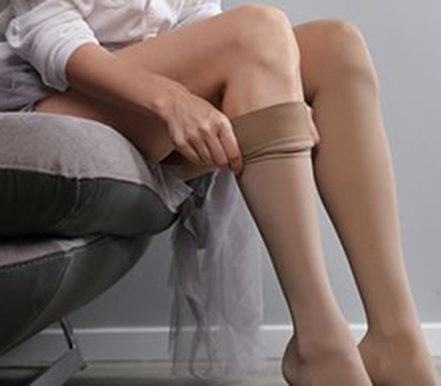 wear compression socks using a silicone band