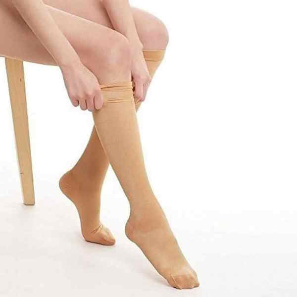 Wearing skin color compression stockings