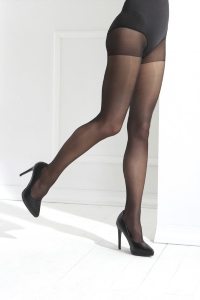 woman wearing black medical compression stockings and black high heels