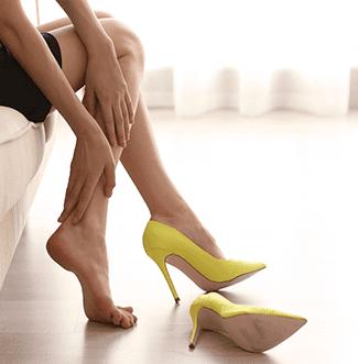 woman tired swollen feet yellow heels